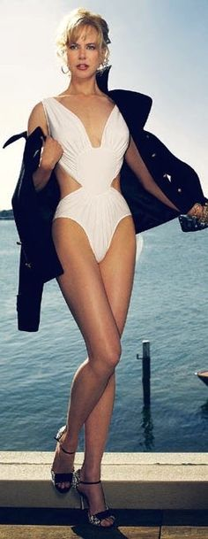 Nicole Kidman long legs in a sexy white one piece and high heels