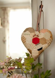 beautiful heart made from a vintage quilt and filled with lavender...use as a pomander year round and hang as a holiday ornament...