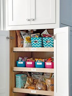 an organized, easy-to-reach snack cupboard for the kids