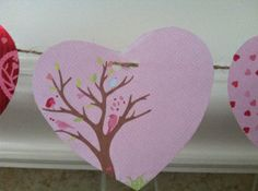Make two hole punches. I tried just one hole punch and when hanging the hearts would hang on their sides instead of straight, facing out.