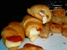 cresant roll with pepperoni and mozzarella sticks rolled up and cooked on 400 degrees til they turn brown...I let the over preheat for 10 mins first,so they didn't cook so quick. they are awesome !!!
