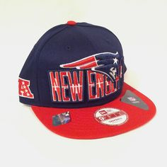 """Manufactured by New Era, this 9FIFTY Flat Bill New England Patriots limited item features a red cloth flat bill with a navy cloth cap. The inner bill has the Patriots name embroidered in thick blue thread. The back features an adjustable snap strap. On the front you will find the Patriots logo embroidered while featuring hte NE name behind it. Features the AFC """"A"""" logo on the side and the Patriots logo on the back. We have 4 quantity of this item available. IN STORE ONLY! Product ID: 018"""