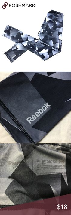 Reebok Running Leggings Size XS Running Leggings by Reebok. Reflective lettering, cute geometric pattern in grey tones. No flaws, inside tag's reflective lettering has faded in wash, as shown. Super cute and flattering, perfect for the gym or just lounging at home! Reebok Pants Leggings