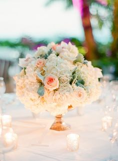Flowers:  Blush and ivory blooms—including roses and hydrangeas with hints of greenery