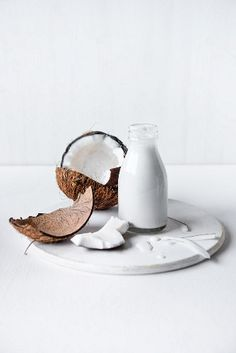 Coconut milk with fresh coconut – License Images – StockFood – 12240165 C. - Coconut milk with fresh coconut – License Images – StockFood – 12240165 Coconut Cream - Milk Photography, Breakfast Photography, Organic Coconut Cream, Coconut Milk, Snacks Saludables, Nutrition Tips, Nutrition Activities, Food Styling, Smoothie Recipes