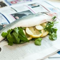 Great idea for a BBQ - newspaper wrapped whole sea bass!