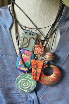 A gaggle of 5 May necklaces by Page's Creations, via Flickr