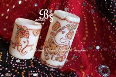 Decorated this set of Ganesha candles for a lovely client's New Year's gift. With all the festivity in the air, sitting by the Christmas tree & creating artwork on these candles - gives me so much pleasure when clients place orders like these. Didn't want to part with them.  www.ArtisticHenna.com https://www.facebook.com/bharathisanghani