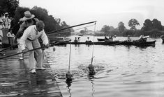 Come in No 2, your time is up: Children learn to swim hanging from a rope..