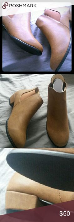 """Distressed cognac ankle booties Brand new distressed cognac ankle booties. Super cute and perfect for the transition to Fall. These booties are true to the size. Faux leather and 1.5"""" heels. May vary slightly in photo due to unique distressing. No offers will be considered unless made through the offer tab and no trades. Thank you. :) boutique  Shoes Ankle Boots & Booties"""