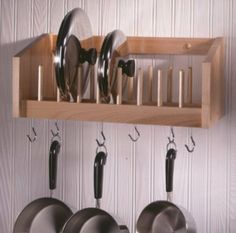 "This compact pot and lid rack holds the lids in an easy to reach location and keeps the lids separated to protect from damage and to make each lid easily accessible. The pots and pans hang from 6 hooks that slide in a track on the two long sides. Additional hooks may be purchased separately. Hand crafted with pride in the USA from select northern hardwoods. Rack measures 19-1/2""W x 9-1/2""D x 8""H."