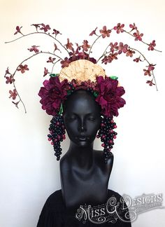 Blossom with pride with a custom made headdress by Miss G Designs.