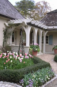 Front yard pergola...create an outdoor 'garden room' to compensate for lack of front porch and balance out garage