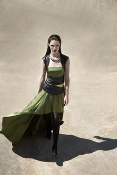 I really like this design.  The high low skirt would be easy to ride in.  Just change the color and the neckline.