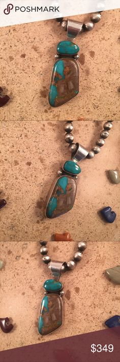 Vintage Navajo Turquoise & Sterling Silver Pendant This is a wonderful handmade piece. The length of the pendant is right at 1 5/8 inches long (total length) and 7/8 of an inch wide. This piece is made from Sterling Silver and Pilot Mountain Turquoise. This piece is signed by the artist Rew Dineh and stamped Sterling (pendant only).  Thank you for checking out our store. Please contact us with any questions. Jewelry Necklaces