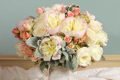 Ivory & coral roses, peonies, hydrangea, stock, dusty miller by Sisters Floral Design Studio. www.stlouisbestbridal.com