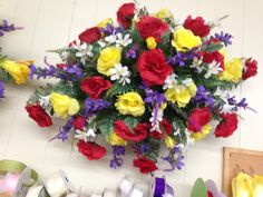 Spring/Summer silk cemetery tomb topper using red and yellow roses with white and purple filler flowers. 2015