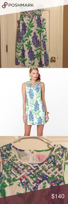 Lilly Ricci Resort Dress This Lilly dress has a white background, blue and coral colored flowers with green leaves. I love the lattice print on this neckline, gives it so much personality! The dress is a size 4. Perfect for bridal and baby showers, weddings or even just a night out! Super cute for summertime! In great shape and has been dry cleaned. Lilly Pulitzer Dresses