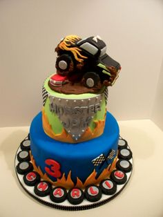 Monster Jam Birthday Cake - Vanilla cake with cream cheese buttercream and fondant. Truck is RKT with fondant/gumpaste, flags are edible images Hot Wheels Kuchen, Hot Wheels Cake, Monster Truck Birthday, Monster Trucks, Monster Jam Cake, Wheel Cake, Truck Cakes, Cake With Cream Cheese, Cakes For Boys