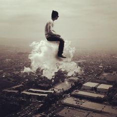 imagination ~ guy riding a cloud!!!  C'mon now, you know we have all imagined doing this...I still do!  :)
