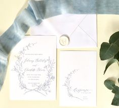 Our beautiful, dusky blue wedding invitation suite. Gorgeous calligraphy and a delicate botanical wreath.