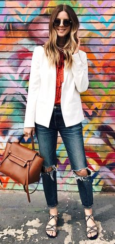 business outfit wearing rips with a whit blazer