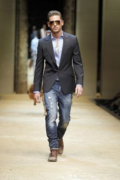 Dolce and Gabbana shows that guys can mix a suit jacket with some jeans and distressed leather shoes for the perfect night-out-on-the-town outfit.