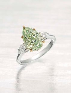 This pear-shaped 3.51ct Fancy Intense green diamond ring, flanked by two white diamonds, is expected to achieve between US$800,000 and $1.2 million at Christie's New York sale of Important Jewels this fall.