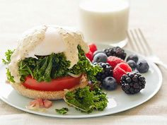 Kale and Tomato Eggs Benedict with Berries (omit meat slice)