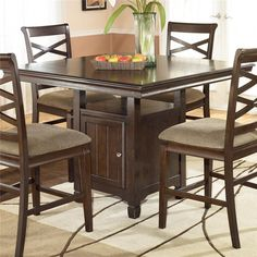 Hayley Contemporary Square Counter Height Pedestal Table with Storage by Ashley Furniture   Part of the Hayley Collection Sku: D480-32 Dimensions: Width: 48  x  Depth: 48  x  Height: 36 Store Availability: In Stock and On Display Compare At Price: $829.99 Sale Price: $449.99