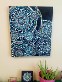 Painting entitled Ripple is a dot mandala painting. Created with acrylic paints on a boxed canvas, sealed with a shiny varnish finish to protect the painting. Crystals, pearls and stones were added after sealing. Beautiful hand painted on of a kind using rich tones to look like water