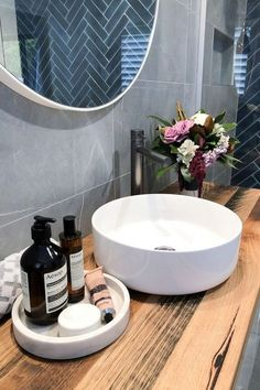 Tiles for bathroom niche - deep sea blue herringbone. Blond timber top vanity