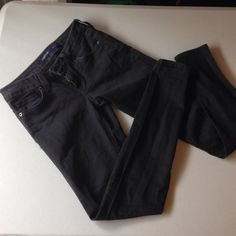Skinny jeans Dark grey low rise pants. Never worn. Just usa Pants