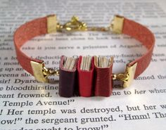 Miniature Book Bracelet The Stacks Stack of Three by JanDaJewelry. For the nerd in me!