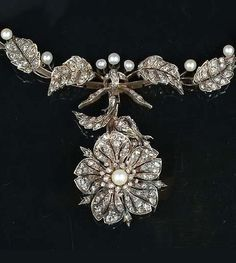 An antique seed pearl and diamond necklace, late 19th century. Composed of a series of rose-cut diamond foliate motifs interspersed with seed pearls, the detachable pendant designed as a rose-cut diamond and seed pearl eglantine rose, mounted in silver and gold, French maker's marks, French assay marks, fitted case by Ad. Mesnard, 14 Palce Dauphine, Bordeaux, length 38cm. #antique #necklace