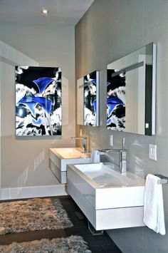 We're always aware of the illuminating effects mirrors can have on a space we often use well placed reflection to create light and add open space to a room. This?  The high gloss acrylic photograph of wildly blue flowers had a reflective quality on its own but when we placed it on the adjacent wall to the mirrors; magic happened. Suddenly the reflections of the photograph turned the room into an invigorating open and vibrant space!  The power of well placed art!