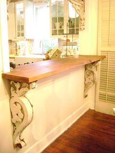 A trip to a salvage store for corbels and to Lowe's for wooden shelf.a nice looking, heavy piece to fill a large space at a fraction of the cost. Corbels make any shelf or counter look great. Cocina Shabby Chic, Shabby Chic Kitchen, Kitchen Decor, Diy Kitchen, Kitchen Pass, Kitchen Ideas, Kitchen Dining, Open Kitchen, Rustic Kitchen