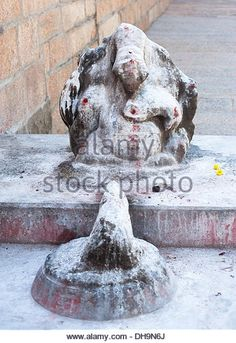 Ganesha statue covered with paint and rice flour as Hindu religious offerings. India - Stock Image