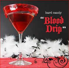 "Vampire's Kiss Cocktail w/instructions on making a hard candy ""blood drip"" on the glass. Yes, it's from a Twilight party planning blog entry, but would still be cool for a Halloween party."