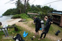 PADI Instructor and one of our Go PRO interns, Missy, assists her PADI Open Water Diver student to don their dive equipment before the first in-water session :)
