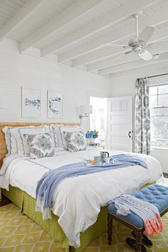 White walls with accents of lapis and yellow-green make this master bedroom fresh and inviting. #newengland #home #design