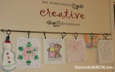 kids art display using curtain rod and clips