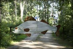 Giant fish made of corrugated iron for gate entrance. Eclectic Landscape by Michelle Fries, BeDe Design, LLC Tor Design, Fence Design, Entrance Design, Lake Dock, Driveway Entrance, Driveway Ideas, Haus Am See, Lake Cottage, Entrance Gates