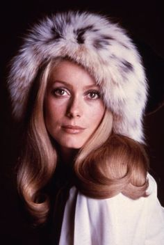 Catherine Deneuve in a fur hat- follow us www.helmetbandits.com like it, love it, pin it, share it!