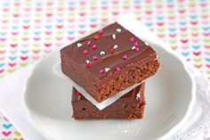 Soft fudge brownies are topped with a thick layer of rich chocolate ganache and make a perfect Valentine dessert to share with your loved ones and friends.