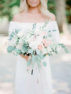 peony, ranunculus, and rose wedding bouquet