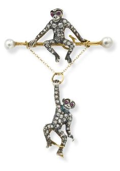 An antique diamond and ruby monkey brooch  Estimate  £1,200 - 1,800    SOLD FOR £5,625