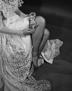 """""""Flowers may be in the bridal picture even when they are not visible to the spectator's eye. Here, for example, a blue garter is trimmed with pink roses, 1950."""" #vintage #bride #wedding #lingerie"""