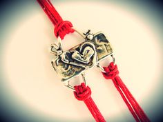 Love this link!  It makes a cool bracelet on red linen cord.  $28 from JewelryByMaeBee on Etsy.