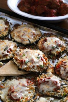 Sheet Pan Eggplant Parmesan is made by baking breaded eggplant slices on a sheet pan until perfectly golden and then topped a robust tomato sauce and mozzarella cheese.